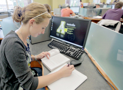 Student working at a computer in the library